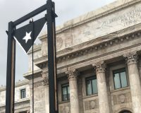 WATCH: Puerto Ricans Bring A Guillotine To Protest Local Leaders At Capital Building
