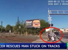WATCH: Hero Cop Saves Man In Wheelchair Stuck On Tracks From Oncoming Freight Train
